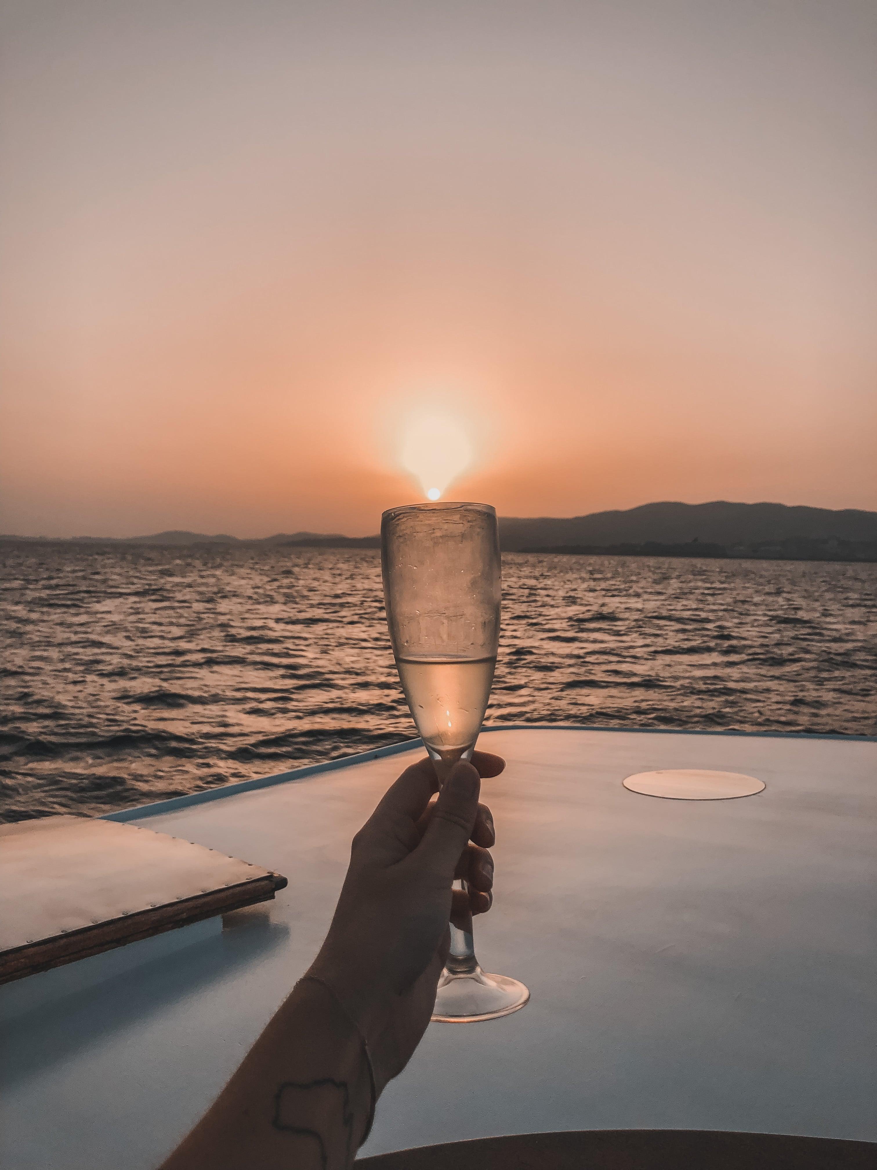 champagne glass sunset boat cruise Mallorca