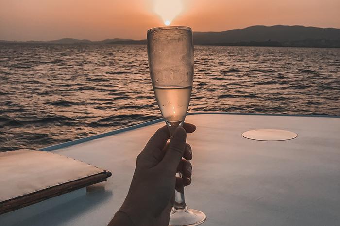 sunset boat cruise Mallorca champagne glass