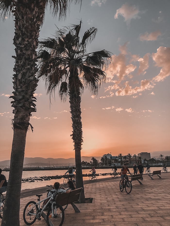 cyclists at sunset Portixol Palma de Mallorca